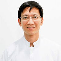 Dr. Kanit Dhanesuan - Oral surgeon in Thailand