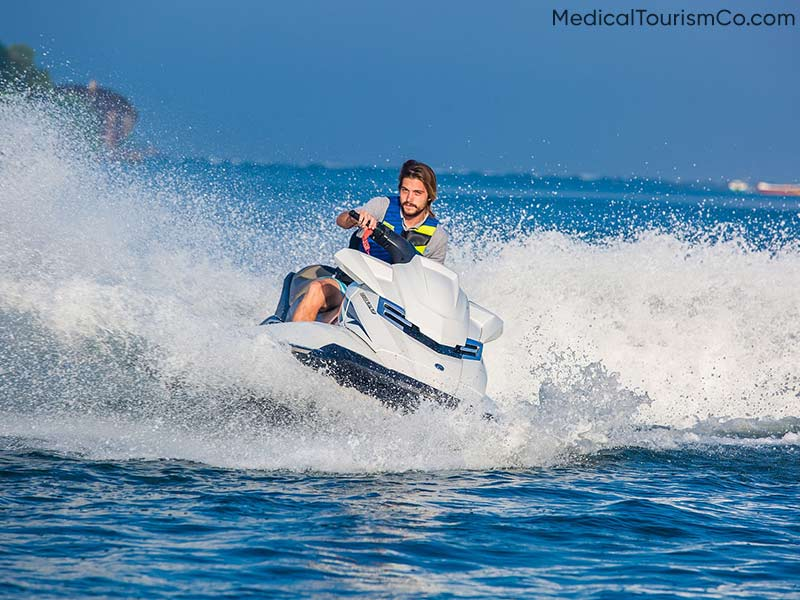 Jet Skiing at Medano Beach   Dental Tourism in Cabo